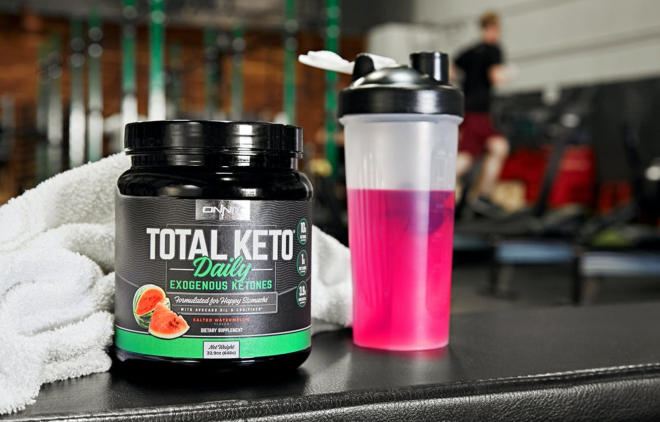 Total Keto Daily at the gym with a shaker bottle